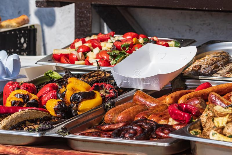 Culinary Buffet with healthy take away meal - grilled vegetables, fish and meat on the street food culinary market, festival, even. T.  Different types of royalty free stock images