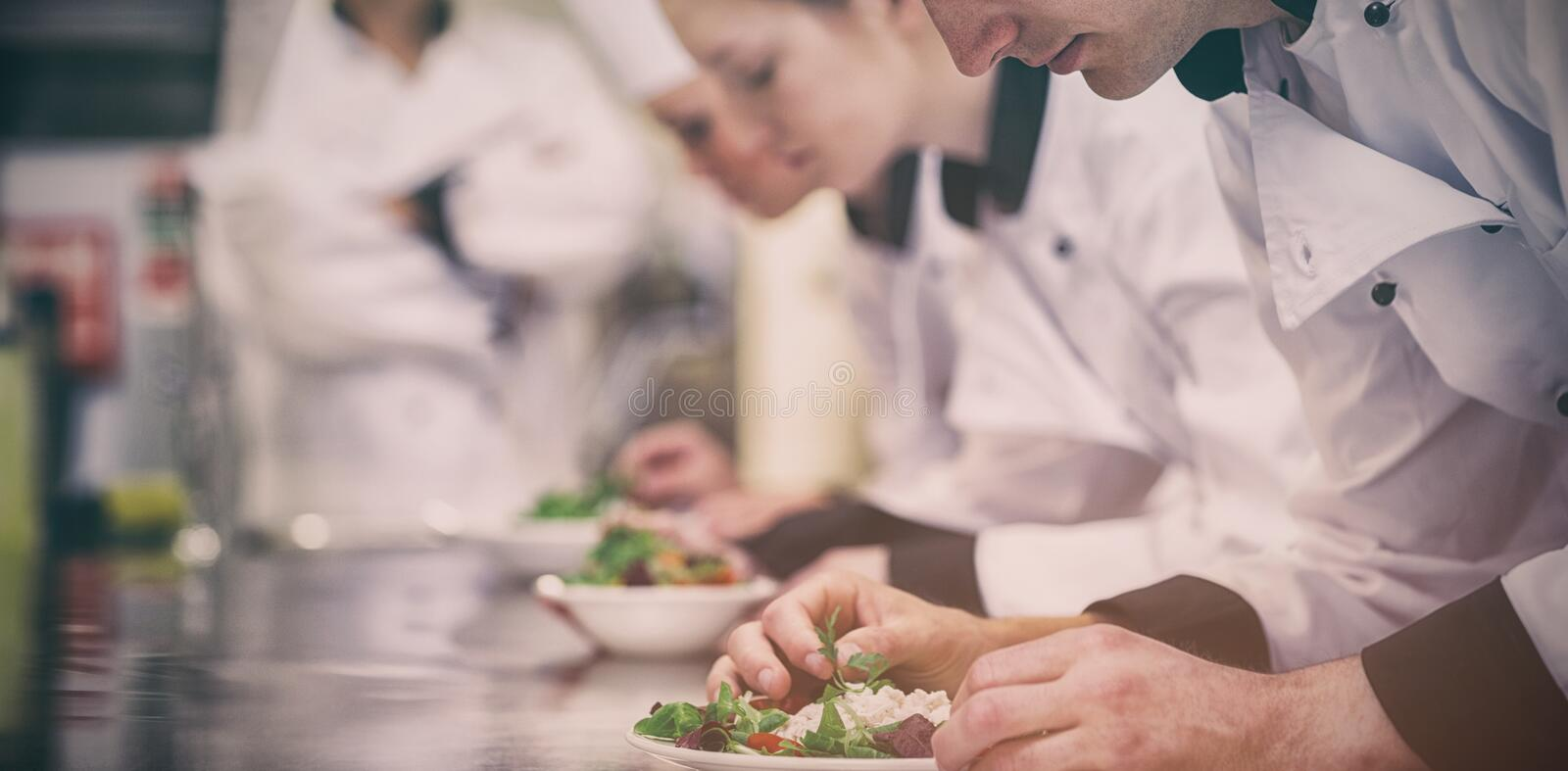 Culinary class in kitchen making salads stock photos