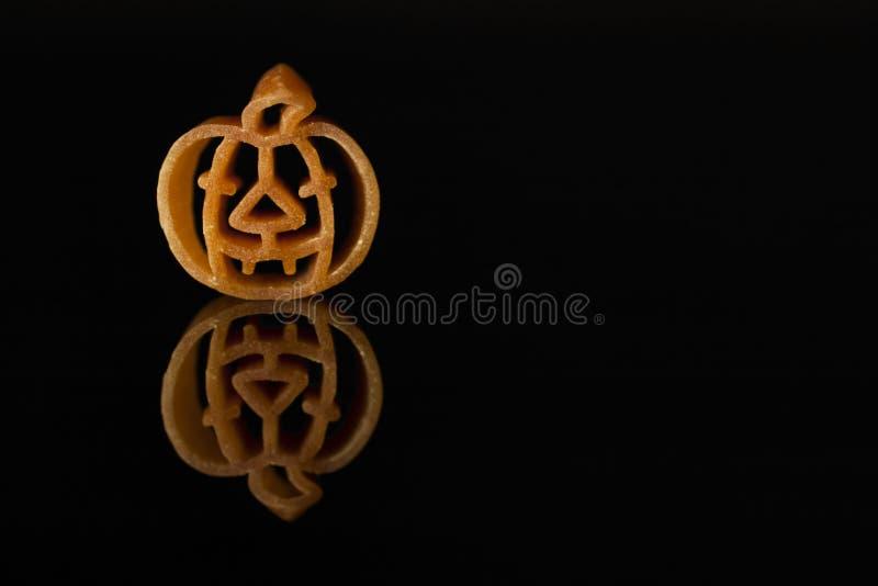 Culinary Halloween. Italian pasta shaped like an orange pumpkin. royalty free stock photography