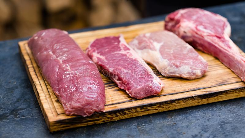 Steakhouse kitchen fresh cuts raw beef meat stock photo