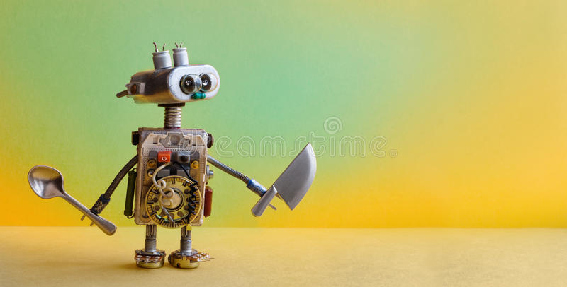 Culinary menu concept chef robot knife spoon. Funny toy cooking character for restaurant food advertising poster. yelloe stock photos