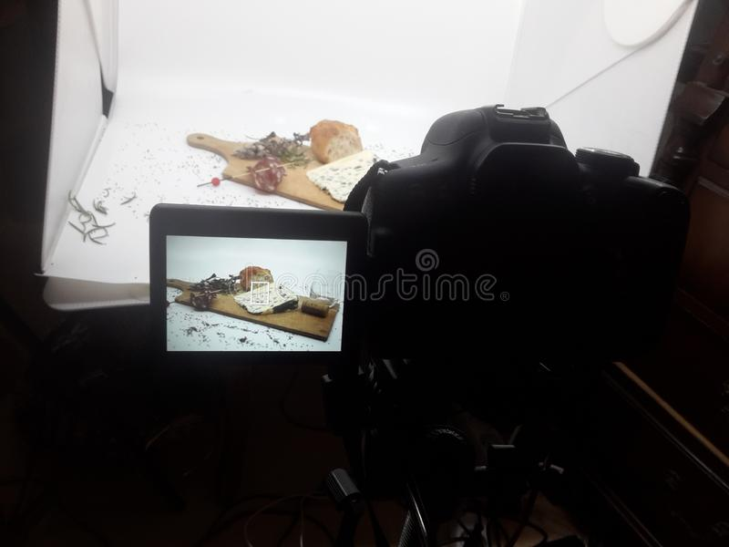 During the culinary photo shoot on French cheeses and french charcuterie. Culinary photo shoot french cheeses charcuterie camera studio photographer work shop royalty free stock image
