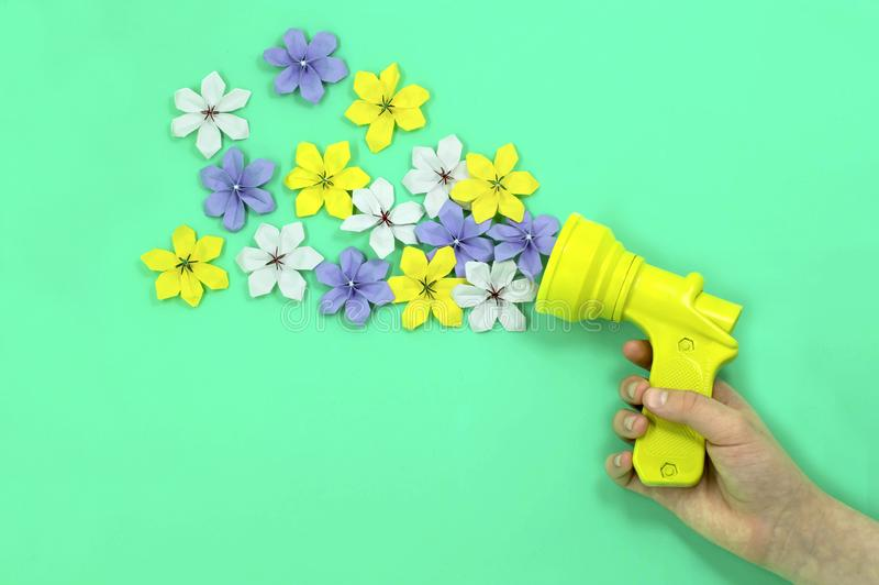 Culinary pistol shoots paper flowers royalty free stock photography