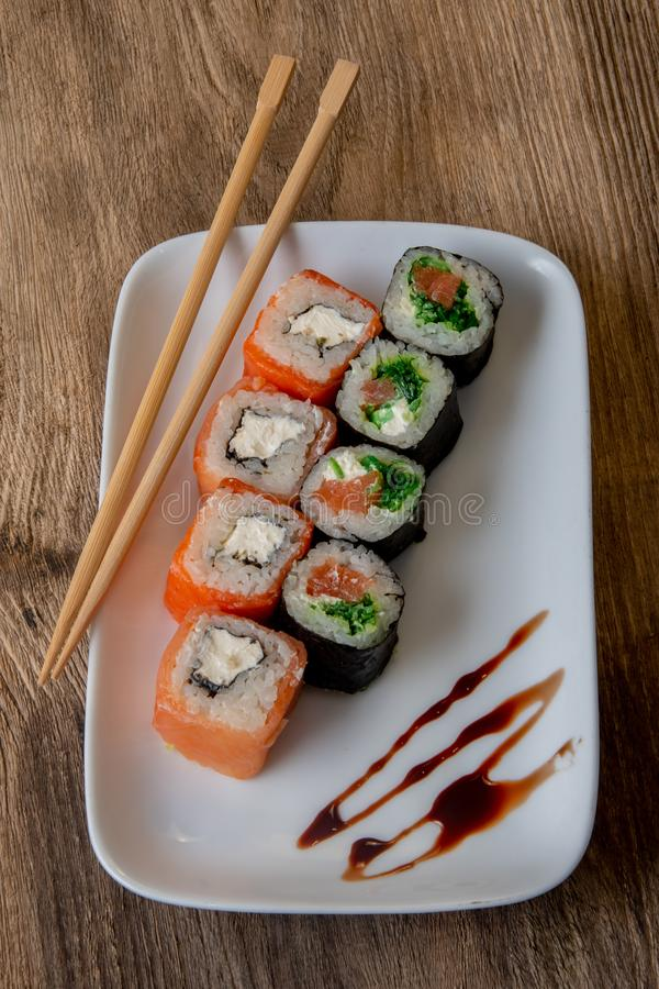 Culinary product, Japanese rolls, fish and rice, chopsticks royalty free stock photography