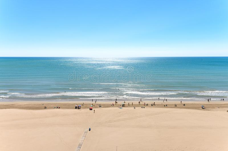 Landscape stock picture of Cullera Beach. In Spain, with people on the beach and blue sky royalty free stock image