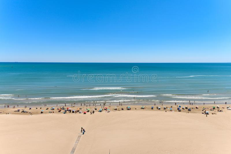 Landscape stock picture of Cullera Beach. In Spain, with people on the beach and blue sky royalty free stock photography