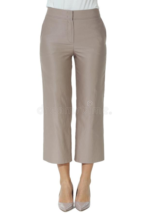 Culottes jeans trousers on model legs with white stiletto heels. With bare toes stock image