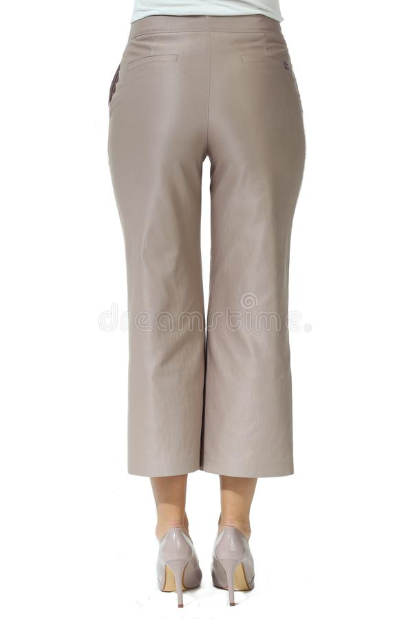 Culottes jeans trousers on model legs with white stiletto heels. With bare toes royalty free stock photo