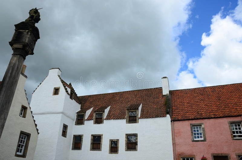 Culross Skyline. A view of buildings and the mercat cross in the medieval Royal burgh of Culross royalty free stock photo