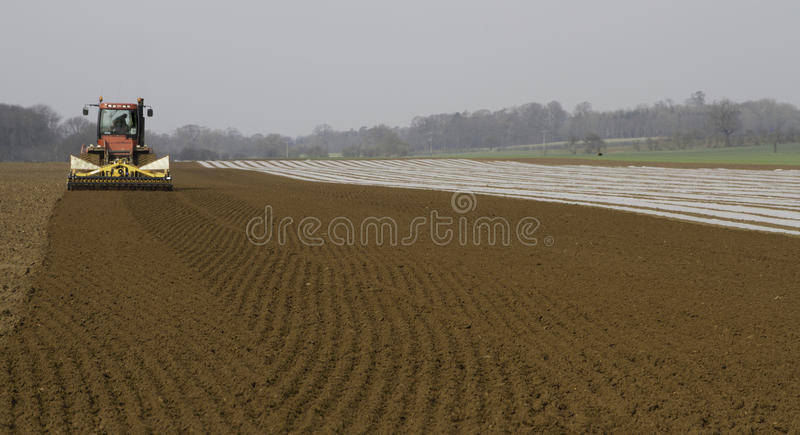 Cultivating land and drilling Maize stock photos