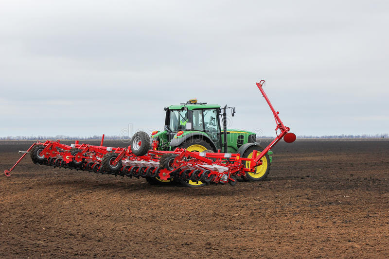 Cultivating tractor in the field. stock photography