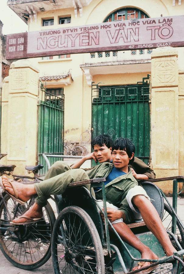 Cultural Continuation:Cyclo drivers in Hanoi, Vietnam, at rest. Cyclo drivers in Hoan Kiem district, Hanoi, Vietnam at rest while waiting for passengers, out royalty free stock photos