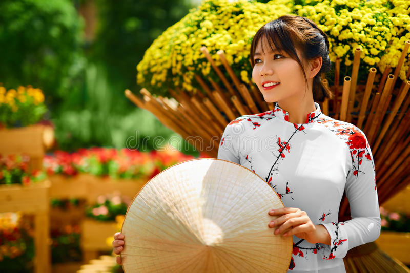 Culture Asia. Asian Woman In Traditional Dress ( Clothes ), Conical Hat. Culture Of Asia. Beautiful Happy Smiling Young Asian Woman Wearing Traditional White Ao stock photo