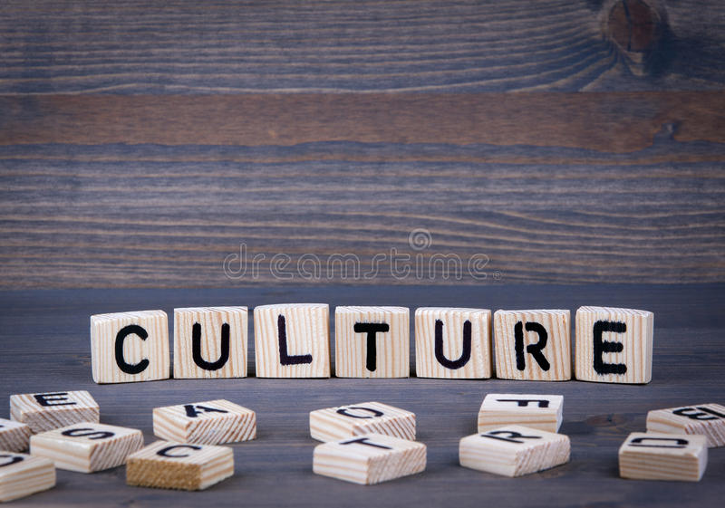 Culture word written on wood block. Dark wood background with texture stock photography