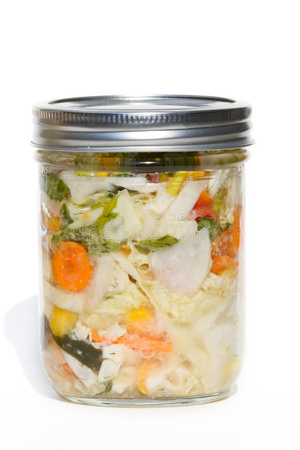 Cultured or fermented vegetables. Jar of cultured or fermented vegetables isolated on a white background stock photos