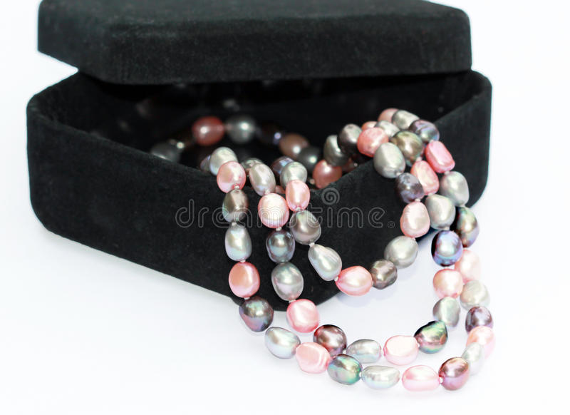 Cultured Pearl. Necklace and black velvet open jewelry box royalty free stock image