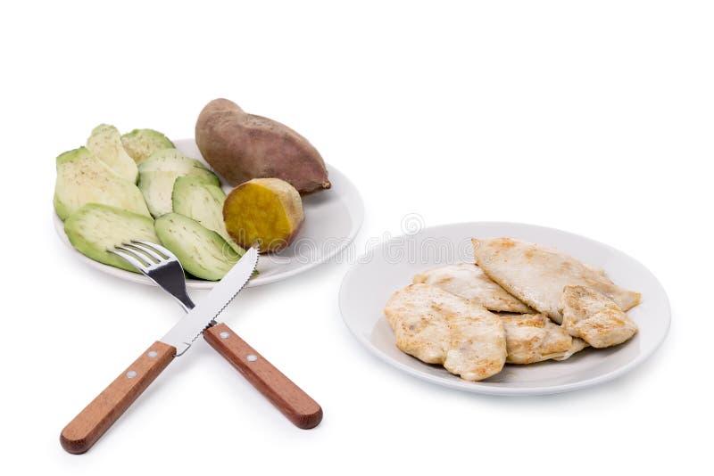 Culturista dell'atleta di dieta Pollo, avocado e patata dolce immagine stock