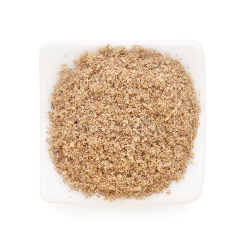 Cumin ground in a white bowl on white background. stock photos