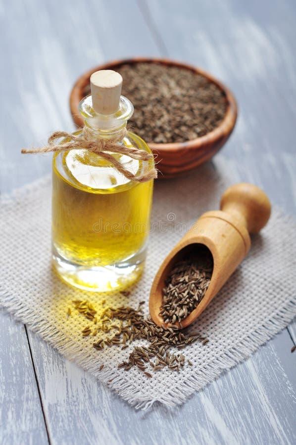 Cumin oil in a glass bottle stock photo