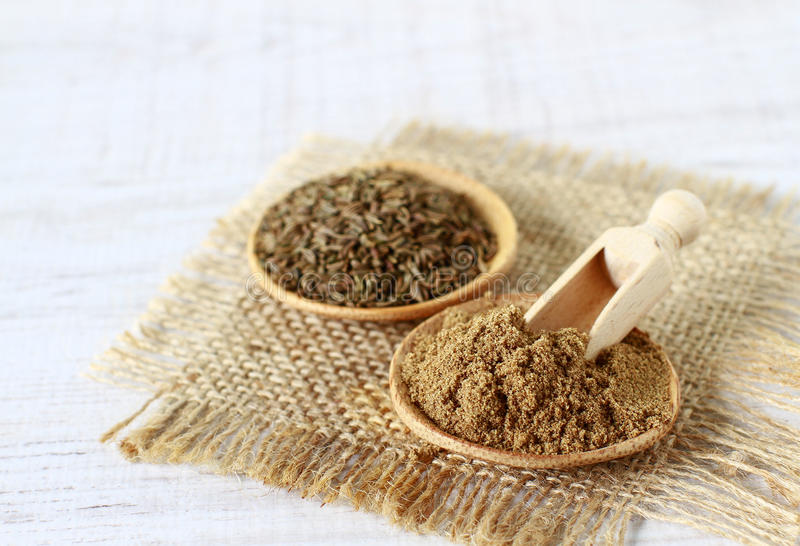 Cumin powder and seeds stock photo