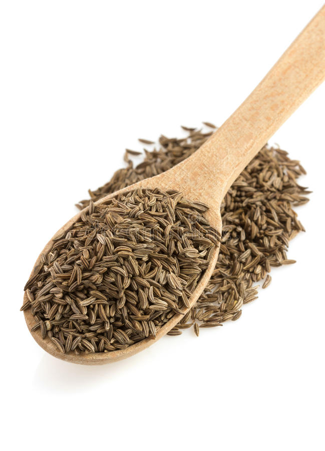 Cumin seeds in spoon. On white background stock photo