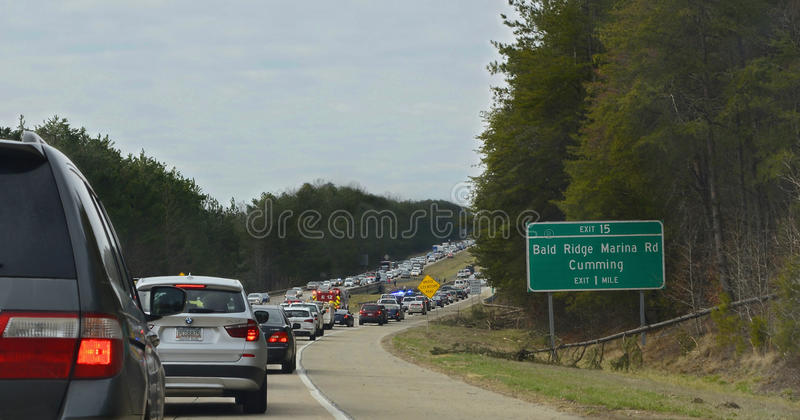 Traffic Jam on a Highway After A Wreck. CUMMING, GA, USA - MARCH 6 - Traffic jam on the highway after a car went into a ditch of water, March 6, 2015 royalty free stock photography