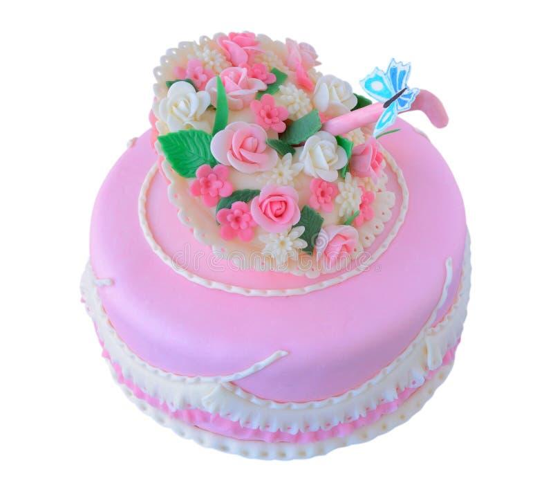 Cumpleaños rosado, pastel de bodas con las flores y imagen de archivo