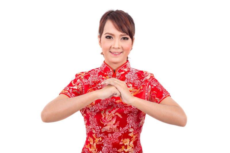 Cumprimento chinês asiático da menina no chinês tradicional imagem de stock