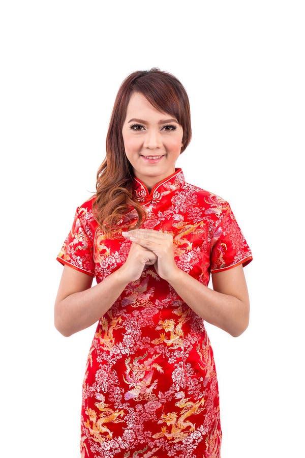 Cumprimento chinês asiático da menina no chinês tradicional fotos de stock