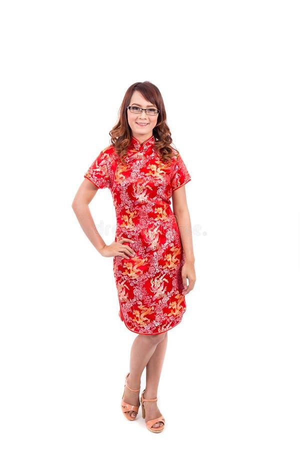 Cumprimento chinês asiático da menina no chinês tradicional imagem de stock royalty free