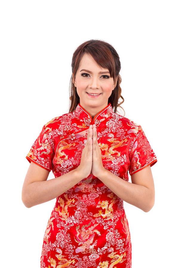 Cumprimento chinês asiático da menina no chinês tradicional, boa vinda imagens de stock