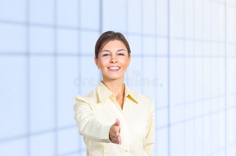 Download Cumprimento Da Mulher De Negócio Foto de Stock - Imagem de vidro, mão: 26509572
