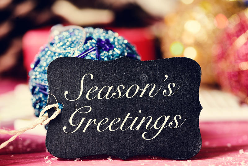 Cumprimentos das estações dos ornamento e do texto do Natal foto de stock