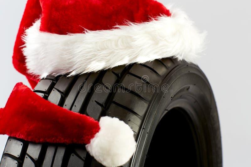 Cumprimentos do Natal para o comércio do pneu fotografia de stock