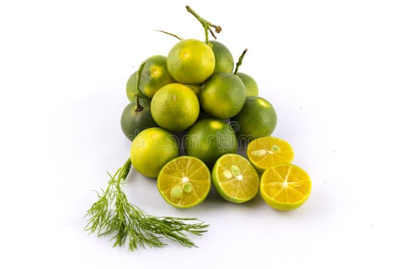 Cumquat or kumquat. With half isolated on white background royalty free stock photography