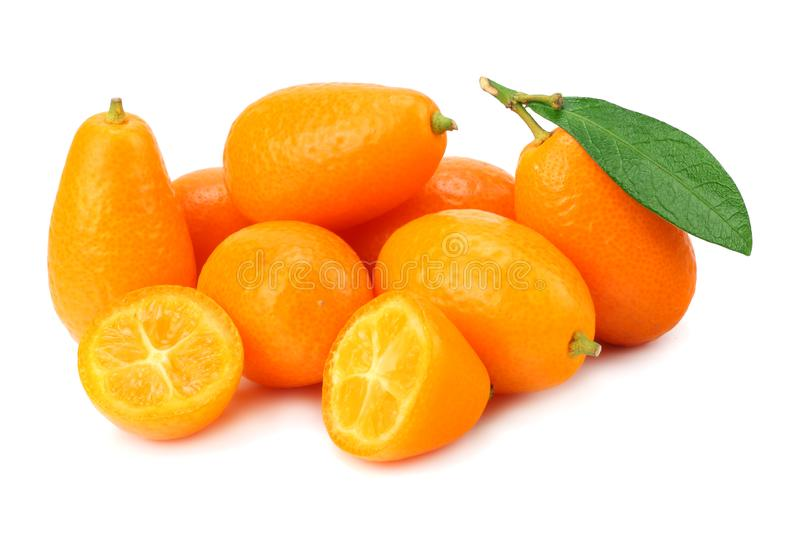 Cumquat or kumquat with slices and leaves isolated on white background royalty free stock photography