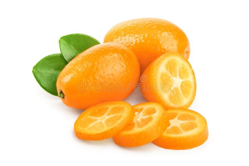 Cumquat or kumquat with slies isolated on white background.  royalty free stock photos