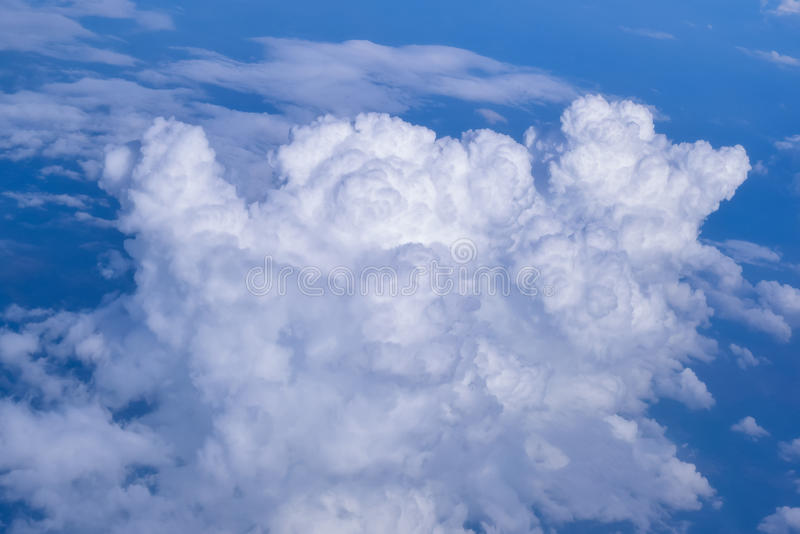Cumulonimbus clouds from airplane during monsoon season in india. Cumulonimbus clouds is a dense towering vertical clouds heap shape often associated with royalty free stock photography