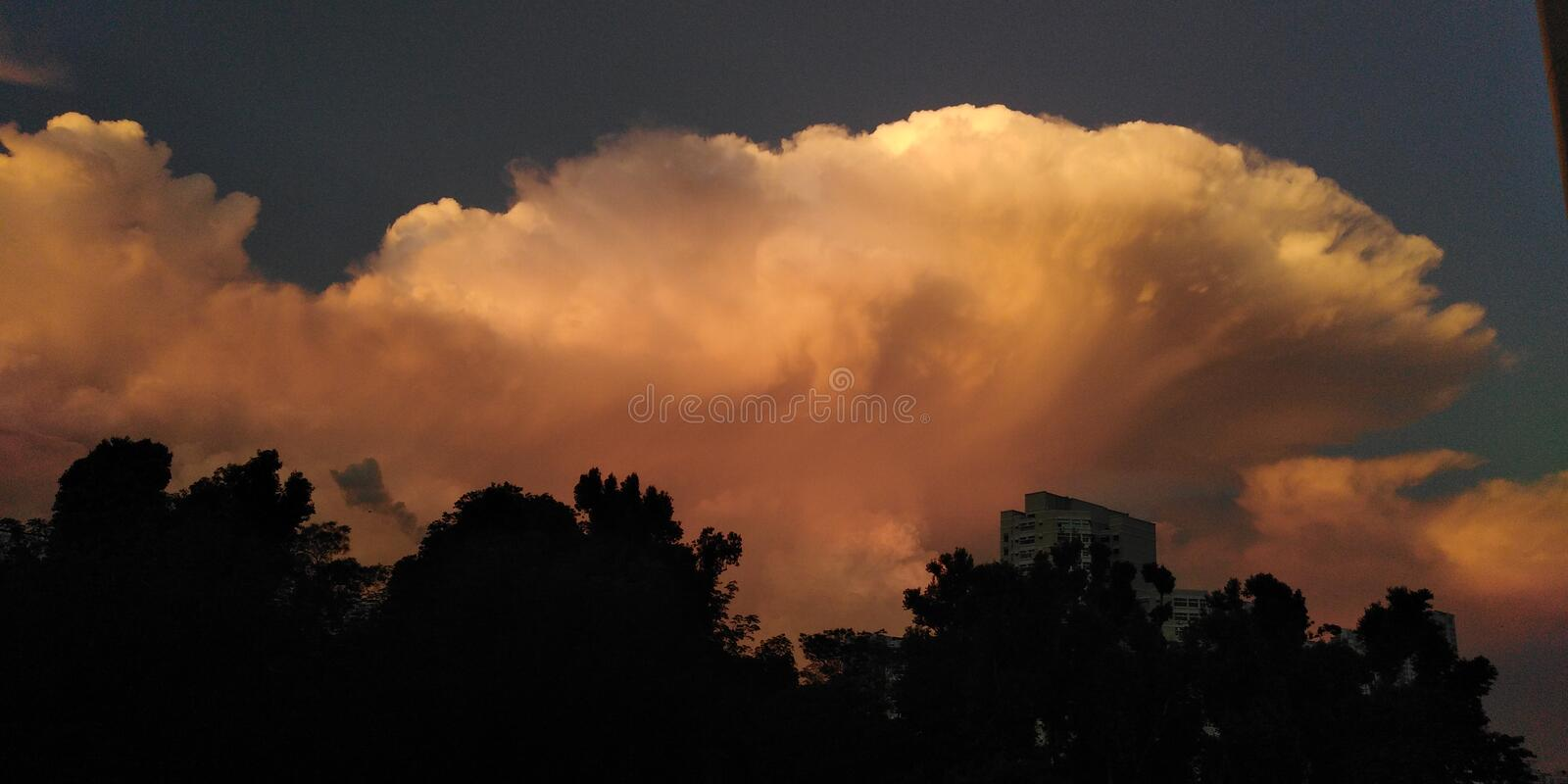 Cumulonimbus clouds in the morning sky | Singapore. Cumulonimbus clouds in the morning sky in Singapore asia tropical weather rain hot warm convection currents stock photography