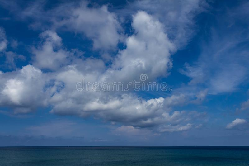 Cumulonimbus over the sea. Clouds in the sky before the storm stock photo