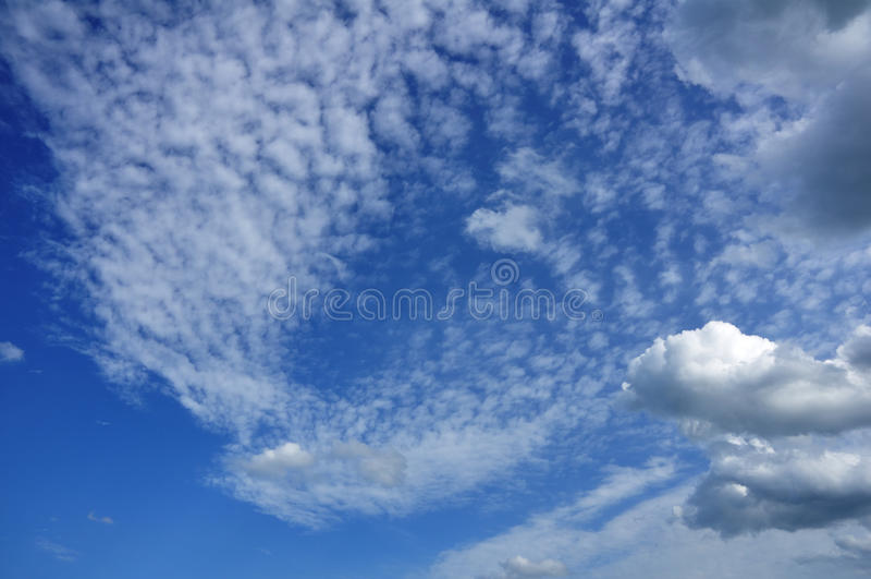 Cumulus And Altocumulus Clouds Stock Images