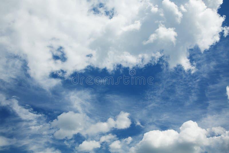 Cumulus and cirrus clouds against a sky. Cumulus and cirrus clouds against a blue sky stock images