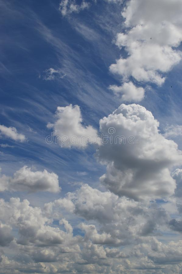 Cumulus and cirrus clouds royalty free stock photo