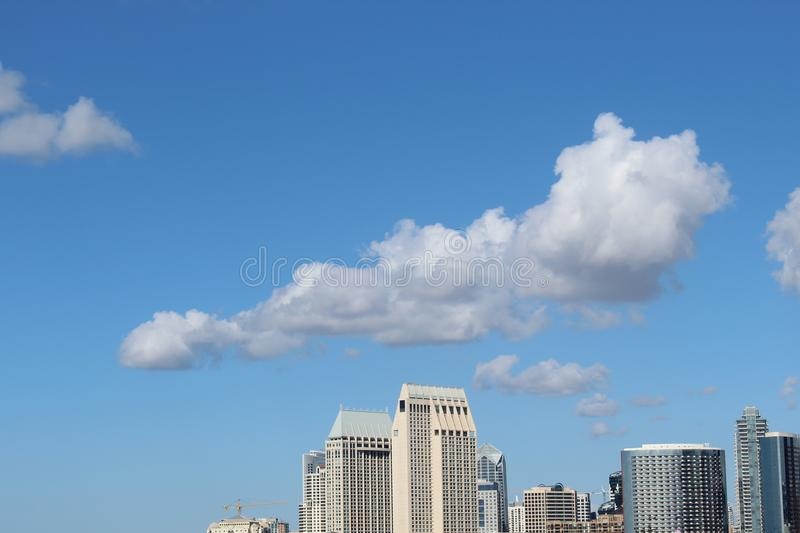Cumulus Clouds Above High-rise Building royalty free stock images