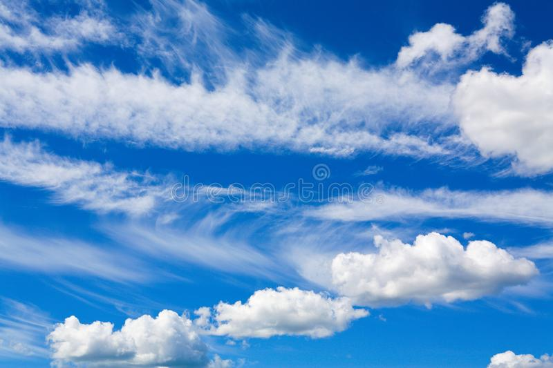 Cumulus clouds in blue sky stock photography