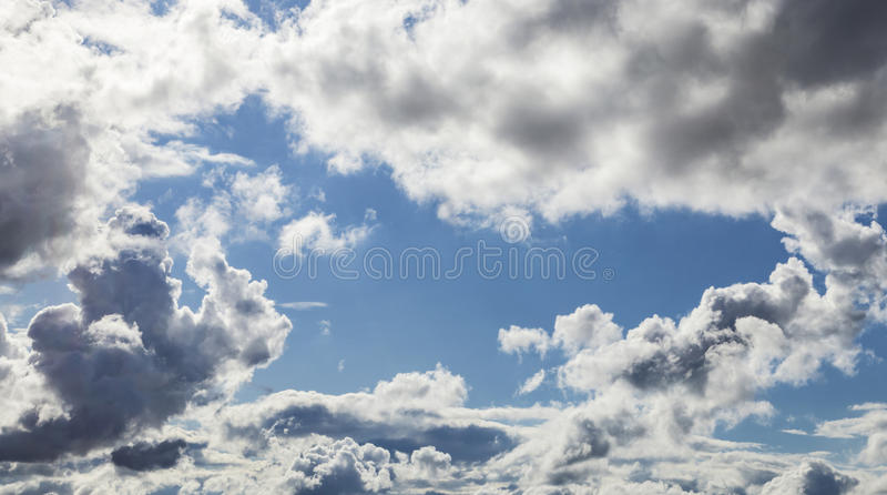 Cumulus Clouds And Grey Storm Clouds Gathering On Blue Sky stock images