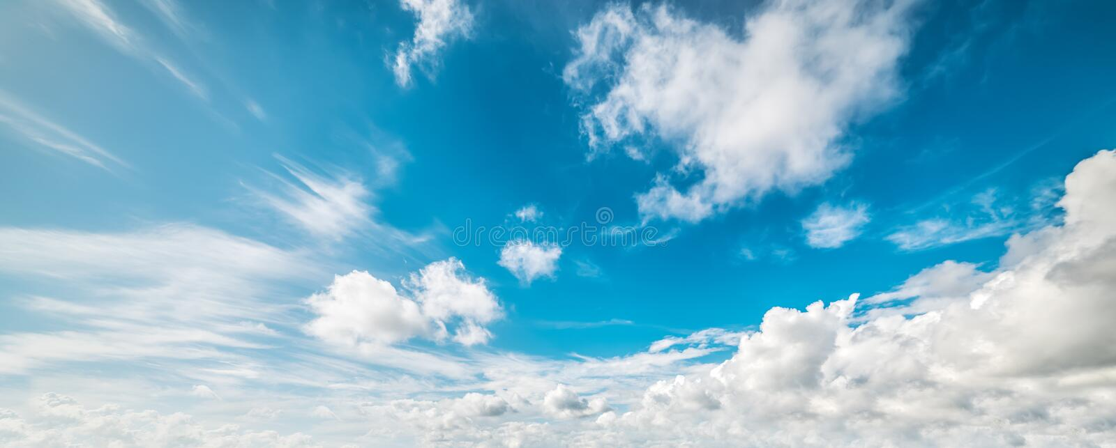 Cumulus clouds in Italy. Blue sky with white, soft clouds stock images