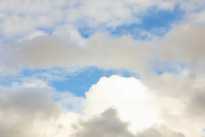 Cumulus clouds lighted background airy light base relaxation relaxed with sunlight high in the sky royalty free stock images