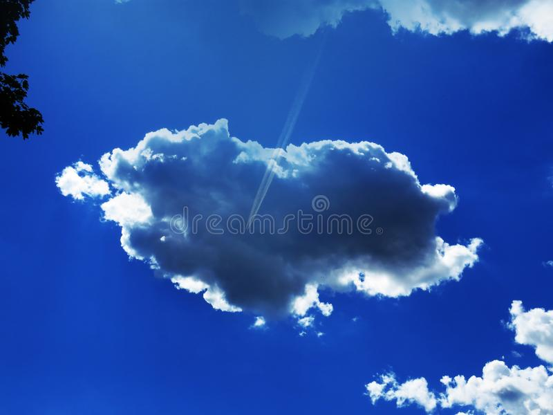 Cumulus clouds with natural patterns on sunny day in summer.Grey rainy clouds. Weather forecast, save environment  concept. Cumulus clouds with natural patterns stock image