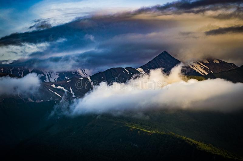 Cumulus Clouds Over Mountain Peak stock image